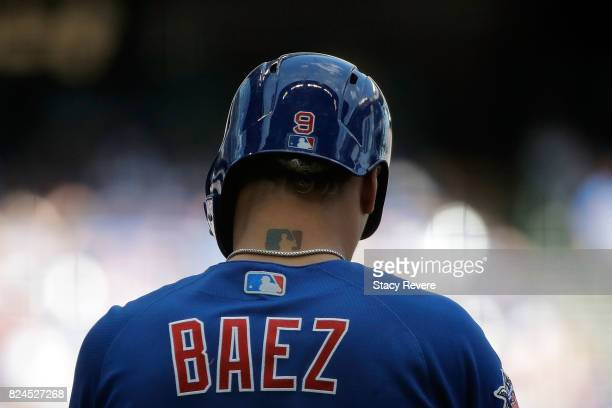Javier Baez of the Chicago Cubs stands on first base during the ninth inning of a game against the Milwaukee Brewers at Miller Park on July 30 2017...