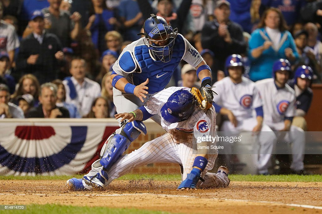 Javier Baez #9 of the Chicago Cubs steals home in the second inning as Carlos Ruiz #51 of the Los Angeles Dodgers is unable to make the tag during game one of the National League Championship Series at Wrigley Field on October 15, 2016 in Chicago, Illinois.