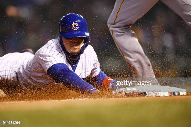 Javier Baez of the Chicago Cubs steals third base during the sixth inning of a game against the Pittsburgh Pirates at Wrigley Field on April 11 2018...