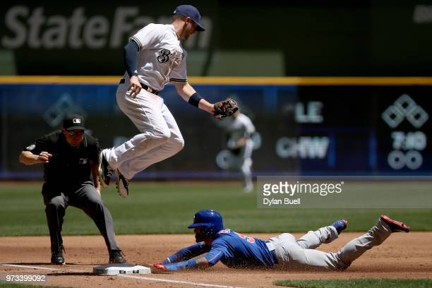 Javier Baez of the Chicago Cubs steals third base past Travis Shaw of the Milwaukee Brewers in the second inning at Miller Park on May 27 2018 in...