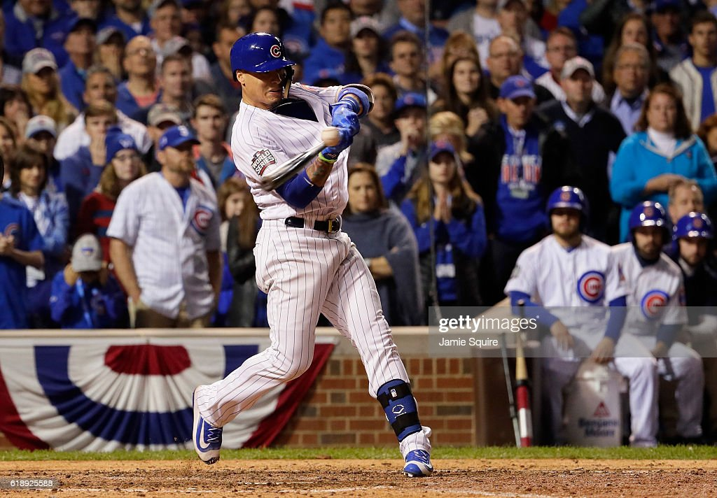 Javier Baez #9 of the Chicago Cubs stirkes out in the ninth inning against the Cleveland Indians in Game Three of the 2016 World Series at Wrigley Field on October 28, 2016 in Chicago, Illinois.