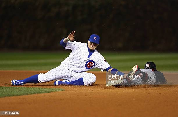 Javier Baez of the Chicago Cubs tags out Francisco Lindor of the Cleveland Indians during a stolen base attempt in the sixth inning in Game Five of...