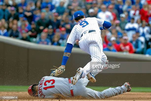 Javier Baez of the Chicago Cubs tags out Matt Carpenter of the St Louis Cardinals at second base during the fifth inning at Wrigley Field on...