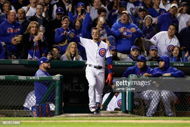 Javier Baez of the Chicago Cubs takes a curtain call after hitting a home run in the fifth inning against the Los Angeles Dodgers during game four of...