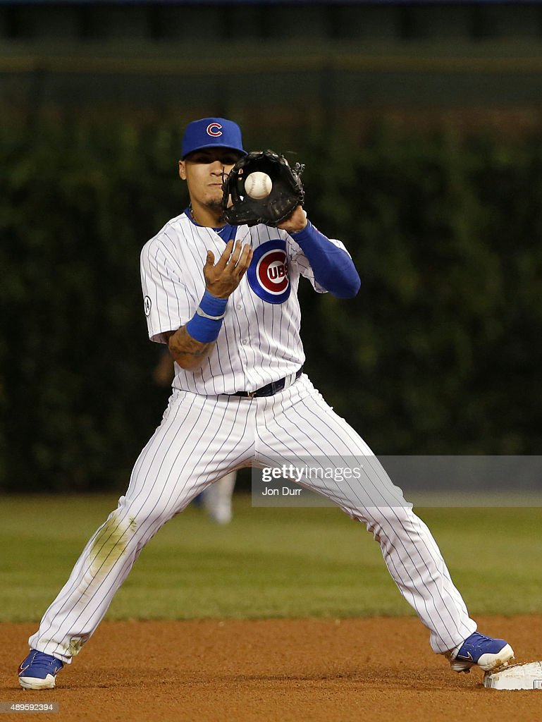 Javier Baez #9 of the Chicago Cubs takes the throw for a force out at second base against the Milwaukee Brewers during the eighth inning at Wrigley Field on September 22, 2015 in Chicago, Illinois. The Chicago Cubs won 4-0.