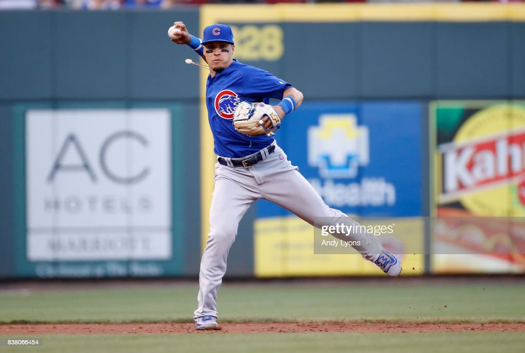 Javier Baez #9 of the Chicago Cubs throws the ball to first base against the Cincinnati Reds at Great American Ball Park on August 23, 2017 in Cincinnati, Ohio.