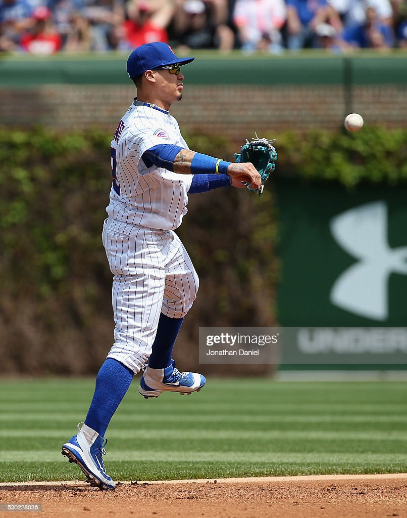 Javier Baez #9 of the Chicago Cubs throws to first base against the Washington Nationals at Wrigley Field on May 6, 2016 in Chicago, Illinois. The Cubs defeated the Nationals 8-6.