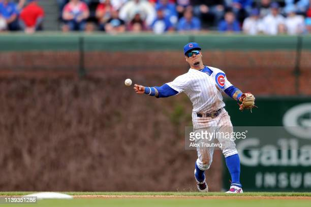 Javier Baez of the Chicago Cubs throws to first base in the sixth inning during the game against the Los Angeles Dodgers at Wrigley Field on Thursday...