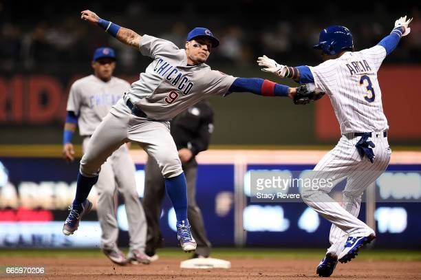 Javier Baez of the Chicago Cubs tries to tag Orlando Arcia of the Milwaukee Brewers during the fifth inning of a game at Miller Park on April 7 2017...