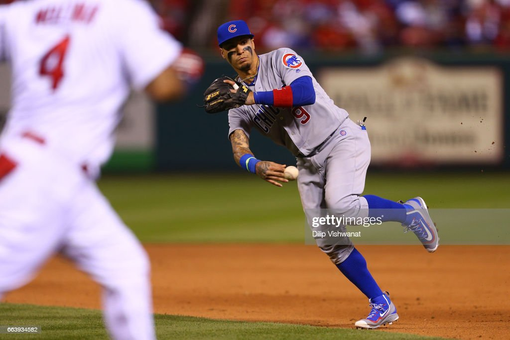 Javier Baez #9 of the Chicago Cubs trows to first base against the St. Louis Cardinals in the seventh inning during the 2017 MLB Opening Day at Busch Stadium on April 2, 2017 in St. Louis, Missouri.