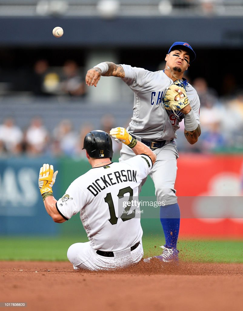 Javier Baez #9 of the Chicago Cubs turns a double play against Corey Dickerson #12 of the Pittsburgh Pirates in the first inning during the game at PNC Park on August 16, 2018 in Pittsburgh, Pennsylvania.