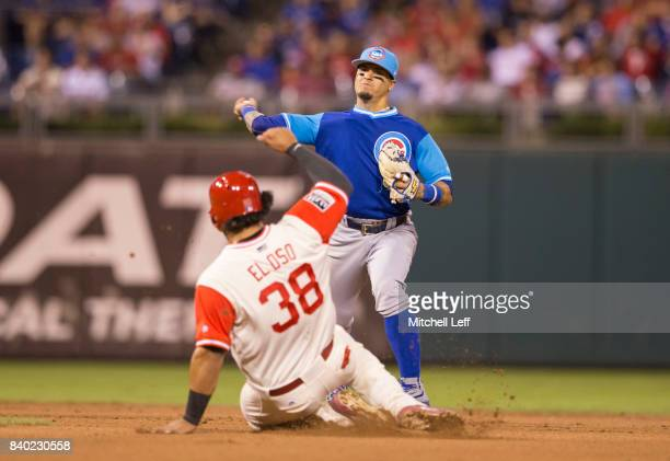 Javier Baez of the Chicago Cubs turns a double play against Jorge Alfaro of the Philadelphia Phillies in the bottom of the fifth inning at Citizens...