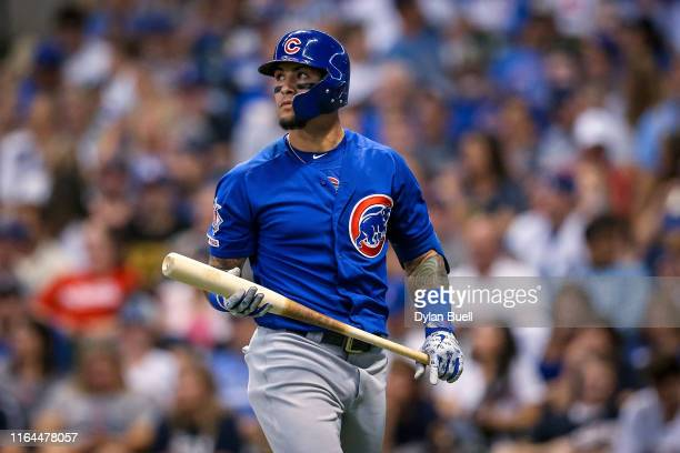 Javier Baez of the Chicago Cubs walks back to the dugout after striking out in the seventh inning against the Milwaukee Brewers at Miller Park on...