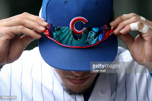 Javier Baez of the Chicago Cubs walks through the dugout before the game against the Chicago White Sox at Wrigley Field on May 12 2018 in Chicago...