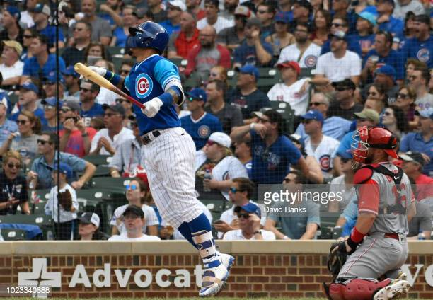 Javier Baez of the Chicago Cubs watches his home run against the Cincinnati Reds during the fifth inning on August 25 2018 at Wrigley Field in...