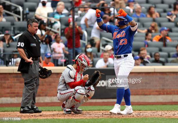 Javier Baez of the New York Mets reacts after hitting a two run home run during the bottom of the fourth inning of a game against the Washington...