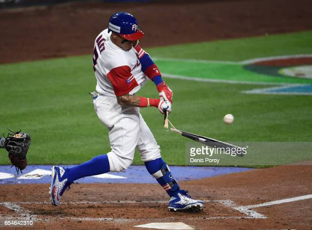 Javier Baez of the Puerto Rico breaks his bat as he hits a single during the first inning of the World Baseball Classic Pool F Game Four between the...