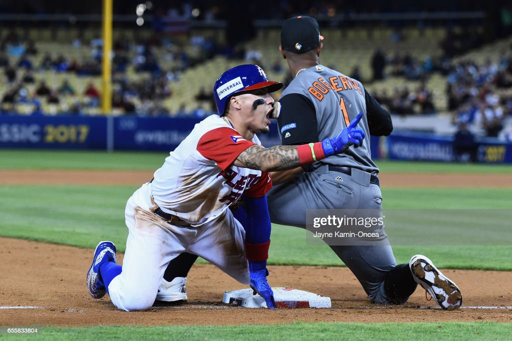 Javier Baez #9 of the Puerto Rico reacts as he beats the tag by Xander Bogaerts #1 of the Netherlands in the during Game 1 of the Championship Round of the 2017 World Baseball Classic at Dodger Stadium on March 20, 2017 in Los Angeles, California.