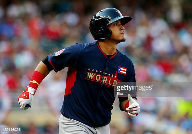 Javier Baez of the World Team rounds the bases after hitting a two-run home run against the U.S. Team during the SiriusXM All-Star Futures Game at...