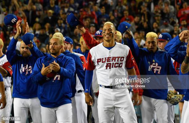 Javier Baez Yadier Molina and teammates of Puerto Rico cheer for team United States after their 80 win during Game 3 of the Championship Round of the...