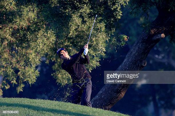 Javier Ballesteros of Spain plays his second shot on the par 5, 10th hole during the second round of the 2015 Omega Dubai Desert Classic on the...