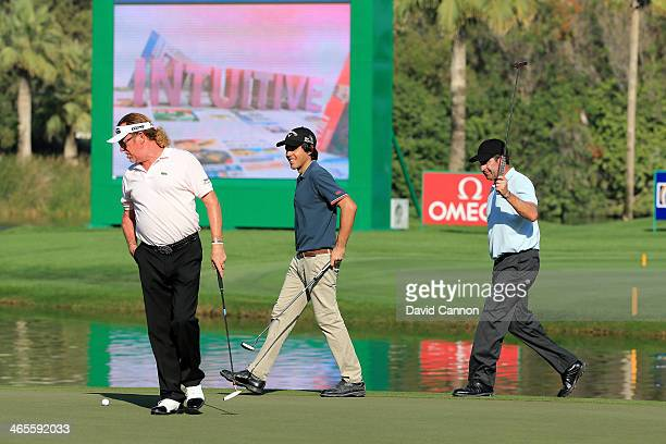 Javier Ballesteros of Spain walks on to the green with Miguel Angel Jimenez of Spain and Jose Maria Olazabal of Spain on the 18th hole during the...
