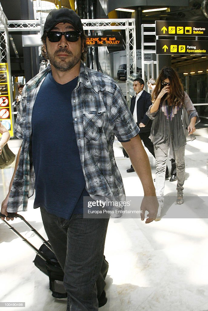 Javier Bardem and Penelope Cruz arrive at the Barajas airport on May 24, 2010 in Madrid, Spain.