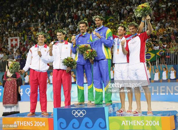 Javier Bosma and Pablo Herrera of Spain Emanuel Rego and Alex Ricardo Santos of Brazil and Stephan Kobel and Patrick Heuscher of Switzerland receive...