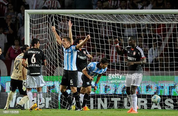Javier Campora of Racing Club celebrates after scoring against Estudiantes de La Plata as part of the 7th round of the Torneo Final 2013 at Ciudad de...