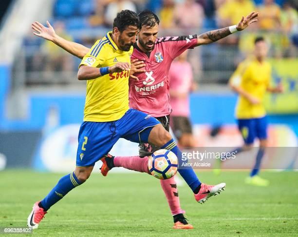 Javier Carpio of Cadiz FC competes for the ball with Tyronne del Pino of CD Tenerife during La Liga Segunda Division between Cadiz CF and CD Tenerife...