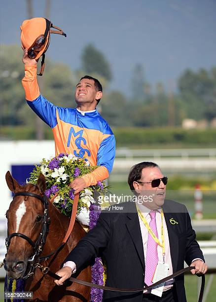 Javier Castellano reacts to his win riding Zagora with owner Martin S Schwartz during the 2012 Breeders' Cup Filly and Mare Turf at Santa Anita Park...