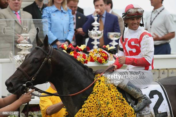 Javier Castellano rider of Cloud Computing celebrates in the winner's cirlce after winning the 142nd running of the Preakness Stakes at Pimlico Race...