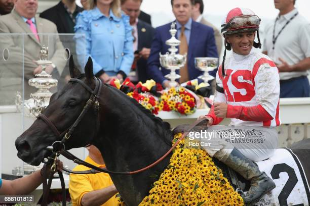 Javier Castellano rider of Cloud Computing celebrates in the winner's circle after winning the 142nd running of the Preakness Stakes at Pimlico Race...