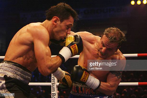 Javier Castillejo of Spain hits Felix Sturm of Germany during the WBA Middleweight Championship Fight between Felix Sturm and Javier Castillejo at...