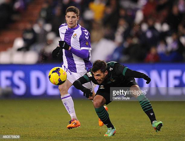 Javier Chica of Real Betis Balompie clears the ball beside Omar Ramos of Real Valladolid CF during the La Liga match between Real Valladolid CF and...