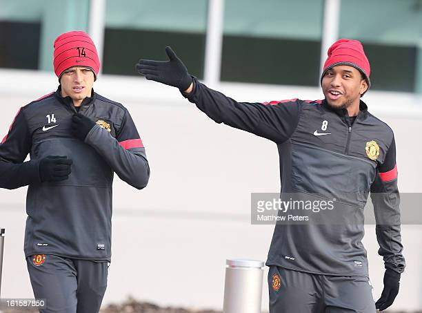 Javier 'Chicharito' Hernandez and Anderson of Manchester United in action during a first team training session ahead of their UEFA Champions League...