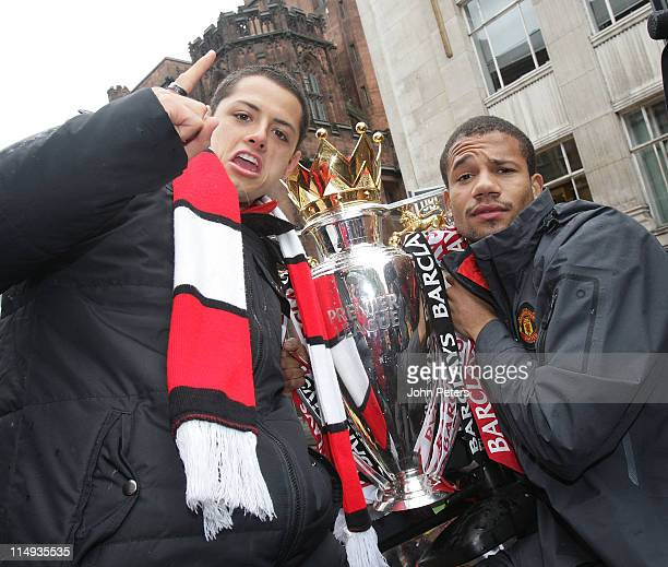 Javier 'Chicharito' Hernandez and Bebe of Manchester United pose with the Barclays Premier League trophy during the Manchester United Premier League...