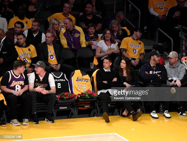 Javier Chicharito Hernandez and guest sit next to the courtside seats the Los Angeles Lakers honored for Kobe Bryant and daughter Gigi by covering...