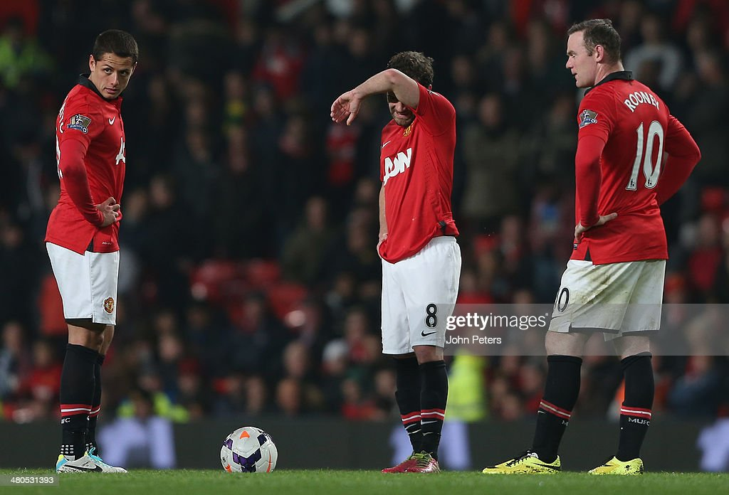 Javier 'Chicharito' Hernandez, Juan Mata and Wayne Rooney of Manchester United react to conceding a third goal to Yaya Toure of Manchester City during the Barclays Premier League match between Manchester United and Manchester City at Old Trafford on March 25, 2014 in Manchester, England.