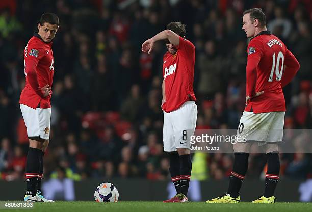 Javier Chicharito Hernandez Juan Mata and Wayne Rooney of Manchester United react to conceding a third goal to Yaya Toure of Manchester City during...
