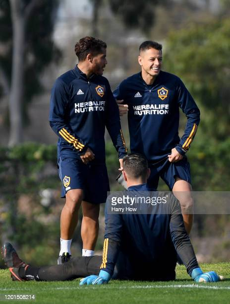 "Javier ""Chicharito"" Hernandez laughs with new teammate Jonathan dos Santos at Dignity Health Sports Park on January 23, 2020 in Carson, California."