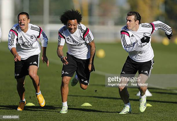 Javier 'Chicharito' Hernandez Marcelo Vieira and Gareth Bale of Real Madrid exercise during a training session at Valdebebas training ground on...