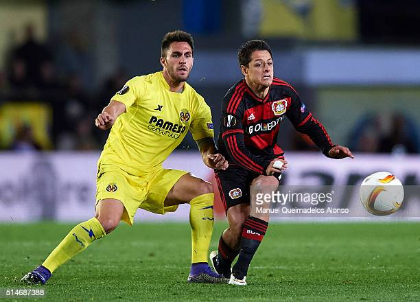 Javier 'Chicharito' Hernandez of Bayer Leverkusen is tackled by Victor Ruiz of Villarreal during the UEFA Europa League Round of 16 first leg match...