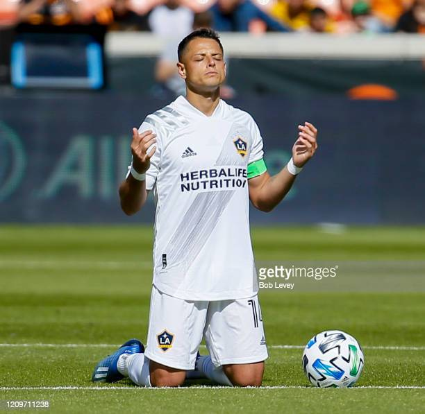 Javier Chicharito Hernandez of Los Angeles Galaxy takes a moment of silence before playing the Houston Dynamo at BBVA Stadium on February 29 2020 in...