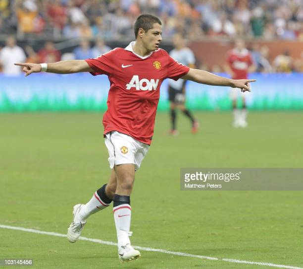 Javier 'Chicharito' Hernandez of Manchester United celebrates scoring their fifth goal his first for the club during the MLS AllStar match between...
