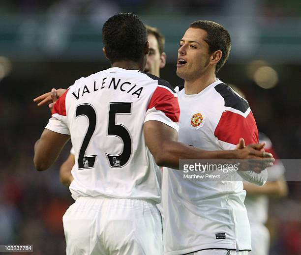 Javier Chicharito Hernandez of Manchester United celebrates scoring their third goal with Antonio Valencia during the preseason friendly match...