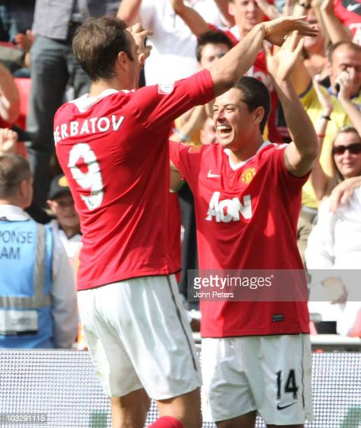 Javier 'Chicharito' Hernandez of Manchester United celebrates scoring their second goal with Dimitar Berbatov during the FA Community Shield match...