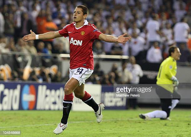 Javier 'Chicharito' Hernandez of Manchester United celebrates scoring their first goal during the UEFA Champions League Group C match between...