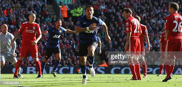 Javier 'Chicharito' Hernandez of Manchester United celebrates scoring their first goal during the Barclays Premier League match between Liverpool and...