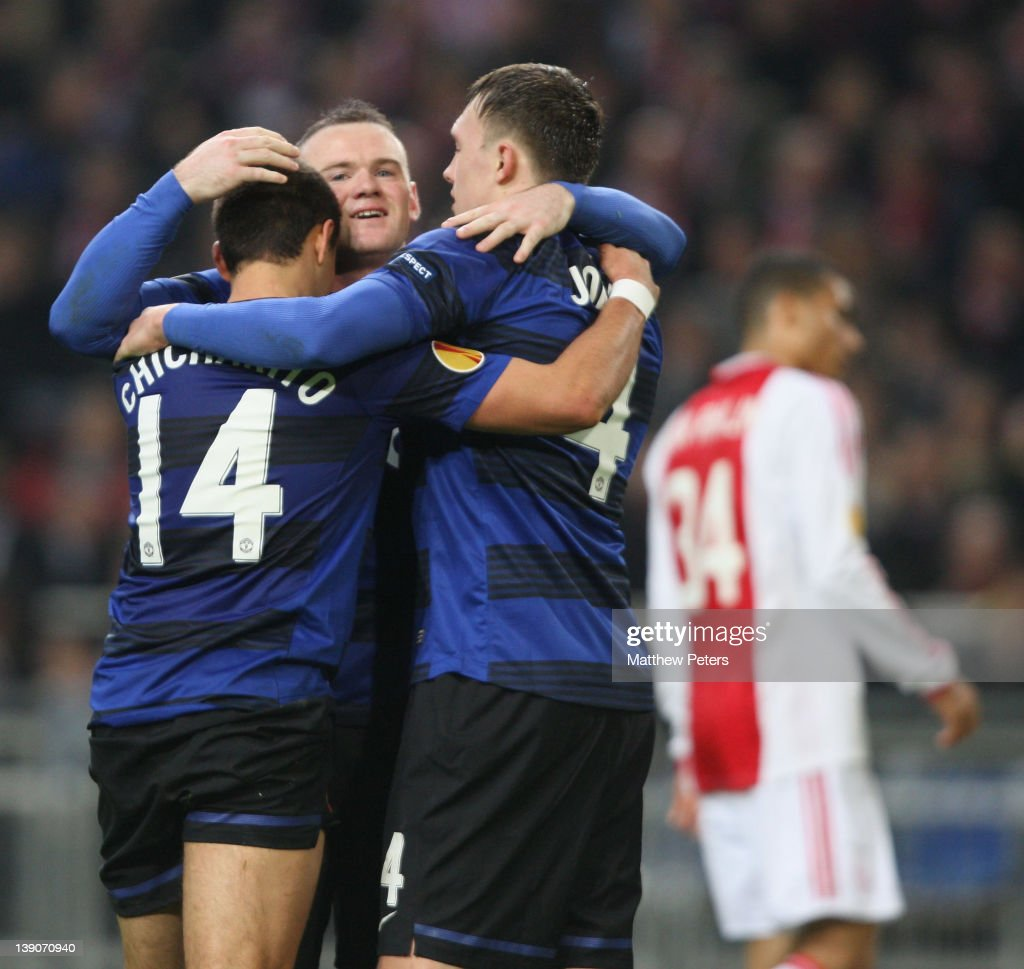 Javier 'Chicharito' Hernandez (L) of Manchester United celebrates scoring their second goal during the UEFA Europa League round of 32 first leg match between AFC Ajax and Manchester United at Amsterdam Arena on February 16, 2012 in Amsterdam, Netherlands.